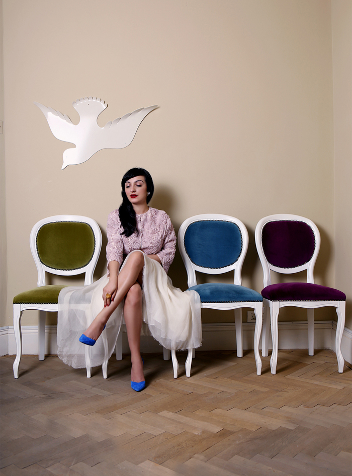 The porcelain Doll and the elegant chairs