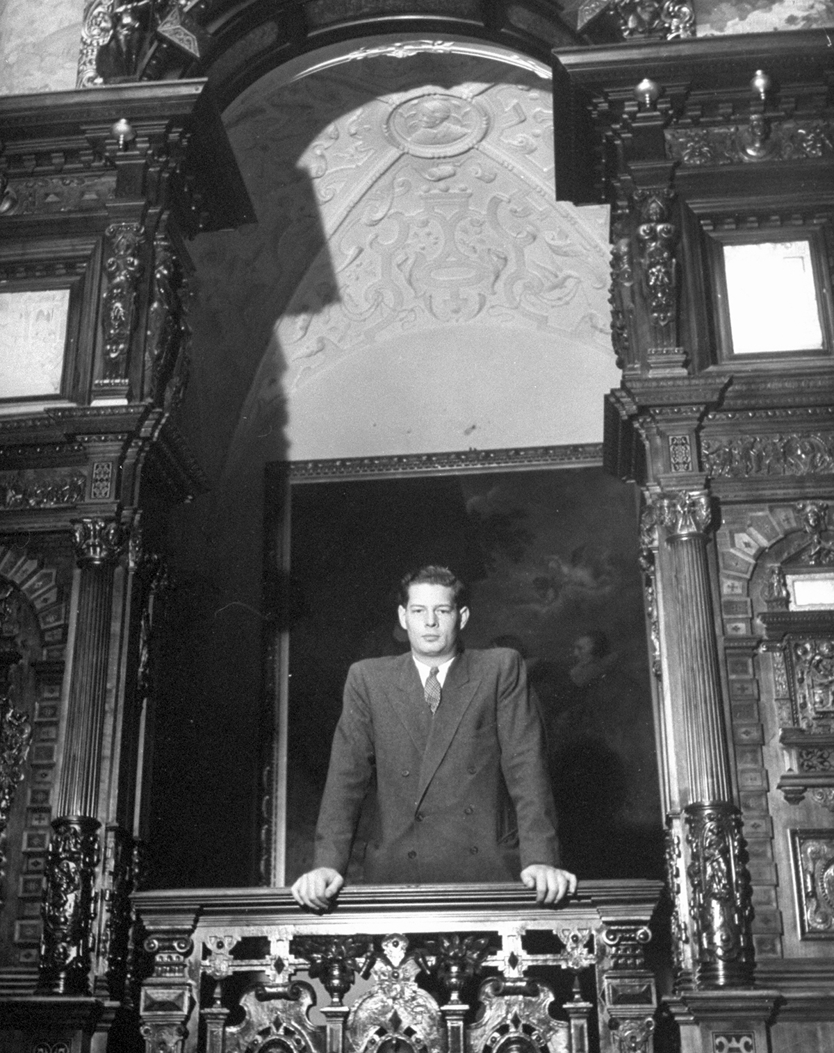 April 1946: Rumanian King Michael leaning over balcony looking into large hall in Sinaia palace.  (Photo by John Phillips/The LIFE Picture Collection/Getty Images)